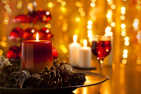 forground: Christmas Decorations and Candles Set on a Dining table Stock Photo
