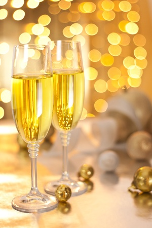 Photograph of champagne glasses set on a table on christmas eve photo