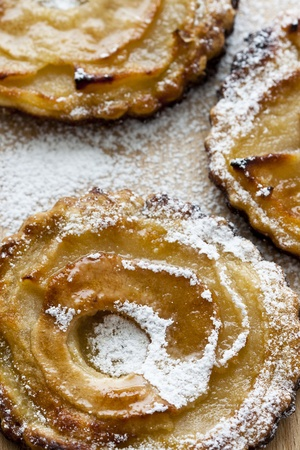Close-up photograph of three tiny apple pies