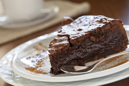 Close up photograph of a slice of chocolate cake