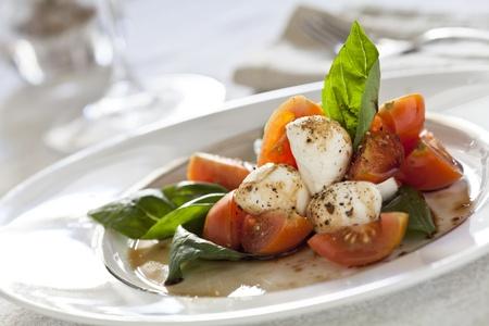 Close up photograph of a tomato and mozzarella salad Stock Photo