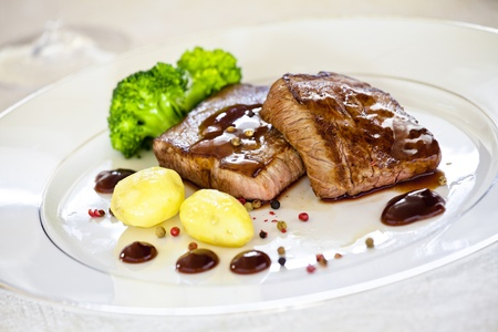 Close up photograph of a gourmet dish with steaks and potatoes Stock Photo