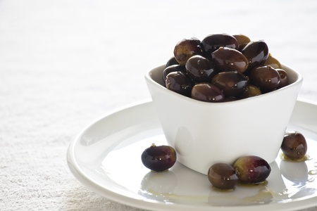 Close up photograph of fresh olives in a bowl