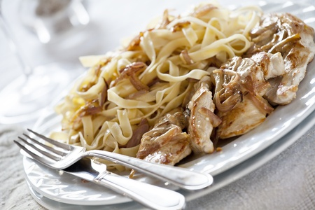 Close up photograph of a pasta and chicken meal Stock Photo