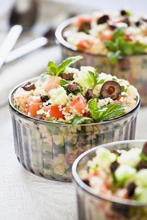 Close up photograph of three bowls of couscous salad Standard-Bild