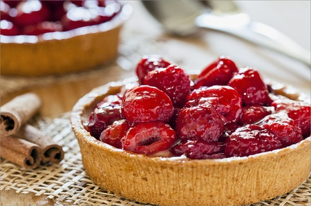 Photograph of two freshly made raspberry pies