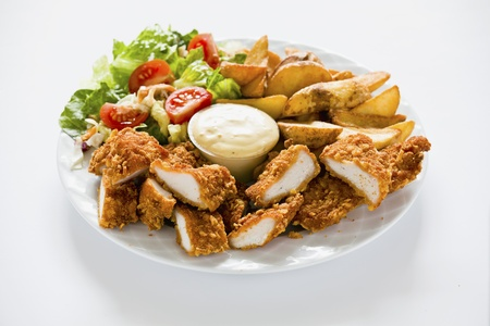 Photograph of Tasty meal with Chicken Nuggets Potatoes and Salad 版權商用圖片