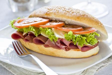 Photograph of a tasty mortadella and salami sandwich