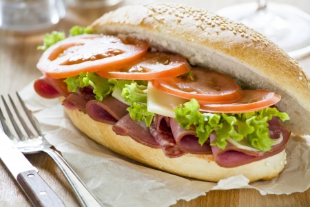 Photograph of a tasty mortadella and salami sandwich