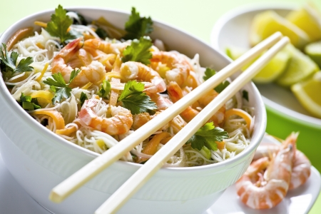 a chinese bowl of noodles with shrimps