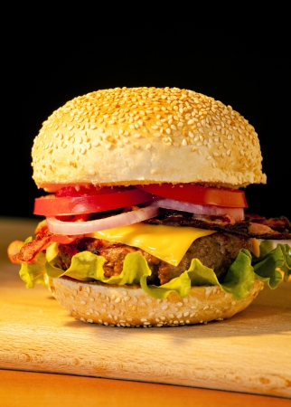 Photograph of a tasty beef and bacon burger Stock Photo