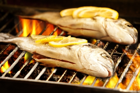 Photograph of two sea breams on the barbecue Stock Photo