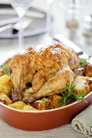 Photograph of a tasty roasted chicken with potatoes