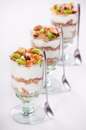 Photograph of a healthy fruit yogurt with cereals Stock Photo