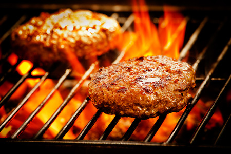Close up of two grilled beef burgers