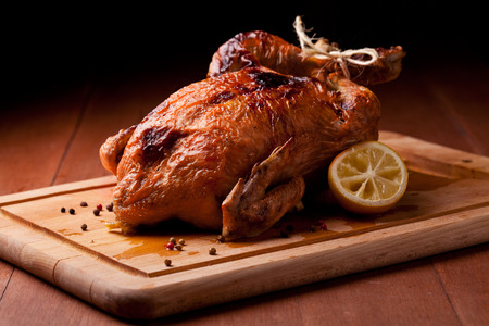 roasted chicken: Photograph of a savory roasted chicken Stock Photo