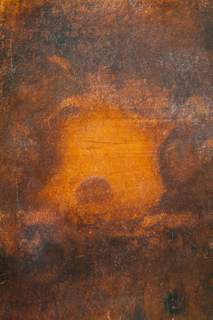 Close up shot of an old rusty piece of metal photo
