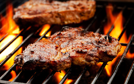 Close up of pork chops on the grill Stock Photo