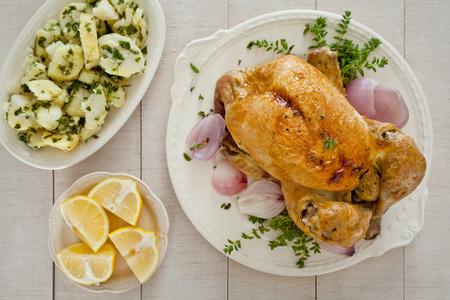 potatoe: Close up of a roasted chicken with potatoe salad