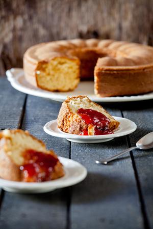 vanilla cake: Photograph of a vanilla cake with strawberry jam Stock Photo