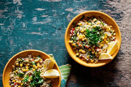Plates of refreshing summer bulgar salad with fresh vegetables Standard-Bild