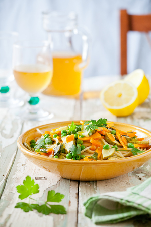 Plate of pasta with some grilled zucchini and carrots with herbs