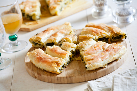 Slices of a homemade greek spinach pie with feta cheese