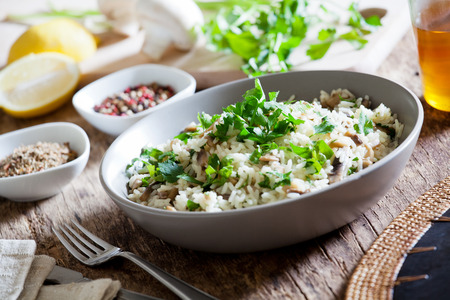 Bowl of homemade rice with wild mushrooms Stock Photo