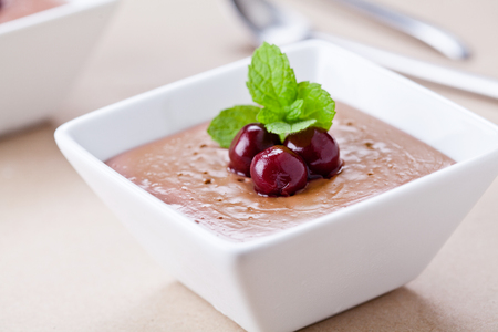 Close up of some homemade chocolate mousse with cherries Stock Photo