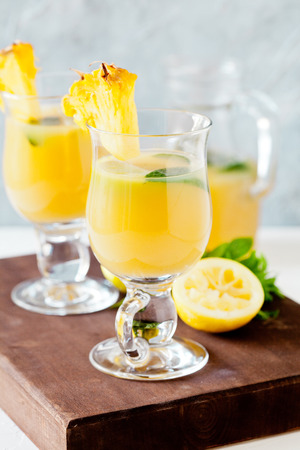 Couple of glasses of refreshing pineapple juice Stock Photo