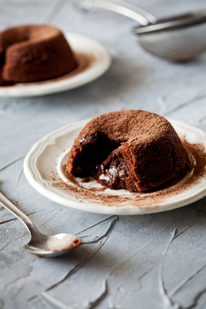 Couple of small homemade chocolate mud cakes Stock Photo