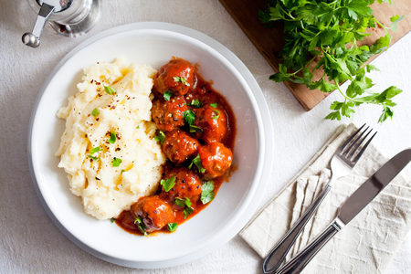 Bowl of homemade meatballs with mashed potatoes and tomato sauce Stok Fotoğraf