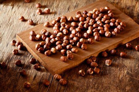 Harvest of a bunch of organic hazelnuts