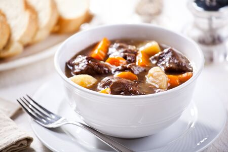 Bowl of homemade boeuf bourguignon with carrots and potatoes