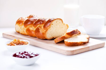 Homemade traditional greek braided brioche with almonds