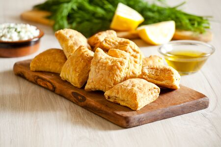 Platter of small homemade greek cheese pies with feta cheese Standard-Bild
