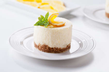 Homemade cheesecake with organic slices of oranges