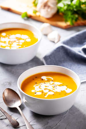 Bowls of homemade soup with organic potatoes and carrots