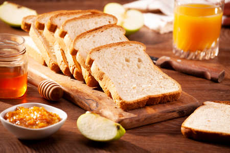 Slices of loaf bread for breakfast with jam and juice