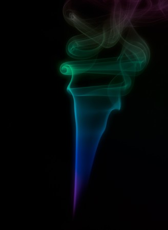 Multi-colored smoke drifting upward on black background Stock fotó
