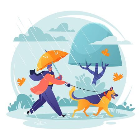 Pet care concept. Man walking his dog in spite of adverse weather conditions. Autumn landscape in rainy day, leaves fall, wind blows. Dog breed German shepherd is happy. His master loves him.