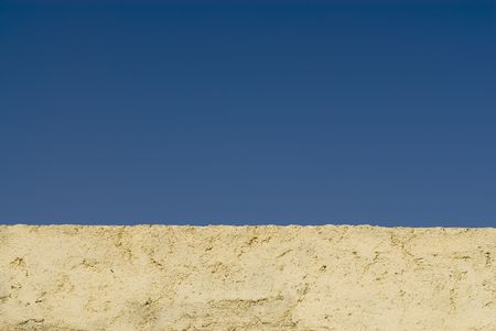 restored: Restored wall in Fez, Morocco on blue sky