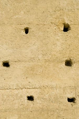 restored: Restored wall in Fez, Morocco with holes