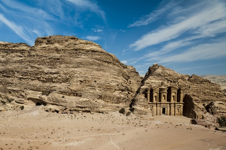 1st century: The Monastery (al-Deir or ad-Dayr in Arabic), a Nabatean structure from the 1st century BC, dominates the crest of a mountain north of Petra's city center. Even at 50 meters in height and 45 meters width, it is dwarfed by its sandstone backdrop. The fla