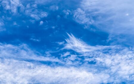 Beautiful white and fine cirrus clouds in a deep blue summer sky