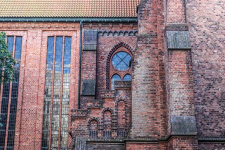 Detailed view on an aged and weathered medieval church building