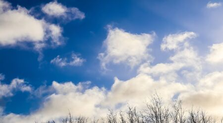 Beautiful view on white fluffy clouds in a deep blue sky
