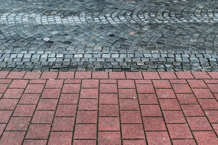 Detailed close up on old cobblestone roads in urban areas and old towns