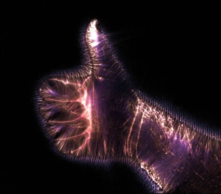 3D-Illustration of a glowing human female hand with a kirlian aura showing different symbols