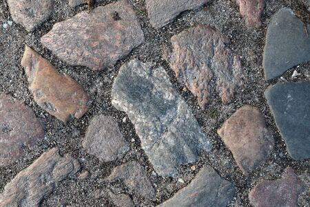 Detailed close up view on cobblestone street textures in high resolution